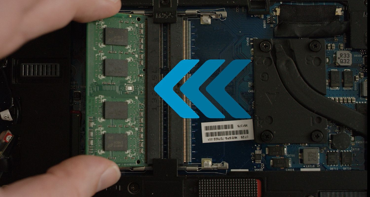 A person installs Crucial RAM module in to laptop